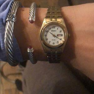 Gold tone Seiko solar watch